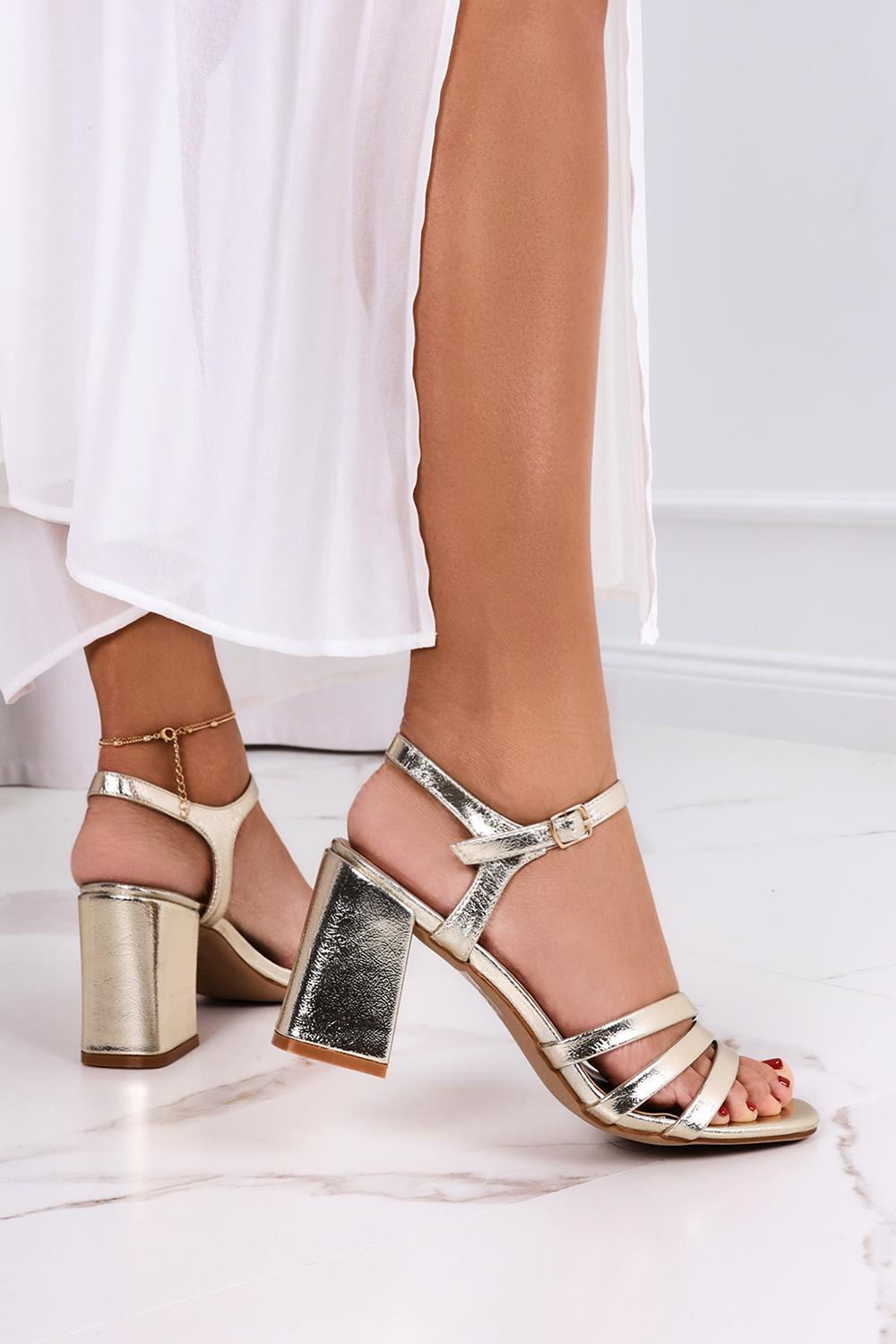 Złote sandały na słupku Casu ER21X7/G